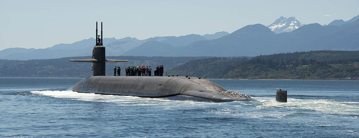 PUGET SOUND, Wash. (July 12, 2018) The Ohio-class ballistic missile submarine USS Nebraska (SSBN 739) transits the Hood Canal as it returns home Naval Base Kitsap-Bangor following the boat's first strategic patrol since 2013. Nebraska recently completed a 41-month engineered refueling overhaul, which will extend the life of the submarine for another 20 years. (U.S. Navy photo by Mass Communication Specialist 1st Class Amanda R. Gray/Released)