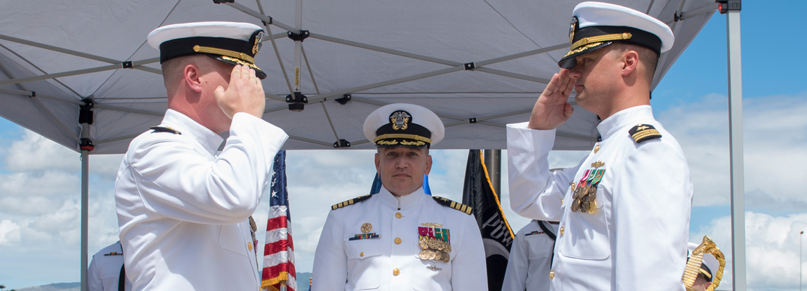 PEARL HARBOR (Aug. 31, 2018) - Cmdr. Brian Turney, left, is relieved of command by Cmdr. Chance Litton, during the Los Angeles-class fast-attack submarine USS Chicago (SSN 721) change of command ceremony at the USS Bowfin Submarine Museum and Park in Pearl Harbor, Hawaii, Aug. 31. Cmdr. Steven Dawley relieved Moller as commanding officer of Chicago. (U.S. Navy photo by Mass Communication Specialist 2nd Class Shaun Griffin/Released)