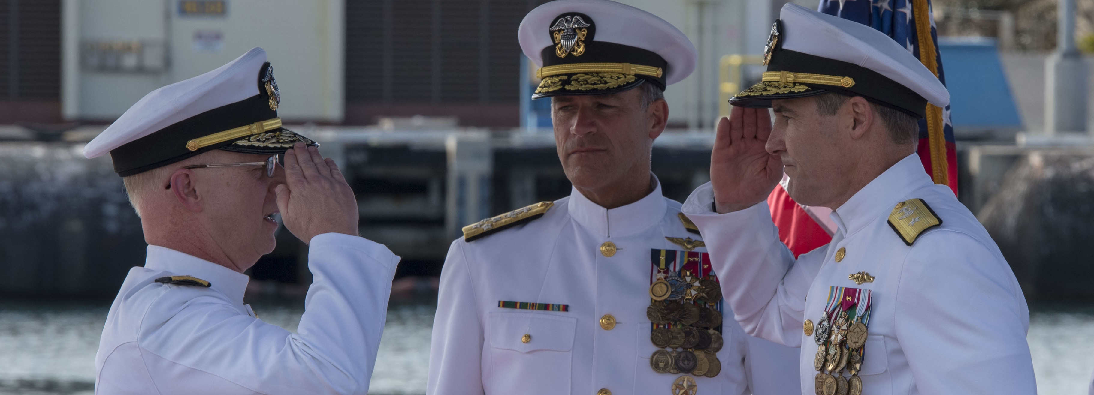 190221-N-KV911-0168 PEARL HARBOR (Feb. 21, 2019) - Rear Adm. Blake Converse, right, relieves Rear Adm. Daryl L. Caudle, left, as the commander of Submarine Force, U.S. Pacific Fleet during a change of command ceremony aboard the Virginia-class fast attack submarine USS Mississippi (SSN 782) in Joint Base Pearl Harbor-Hickam. (U.S. Navy photo by Mass Communication Specialist 2nd Class Shaun Griffin/Released)