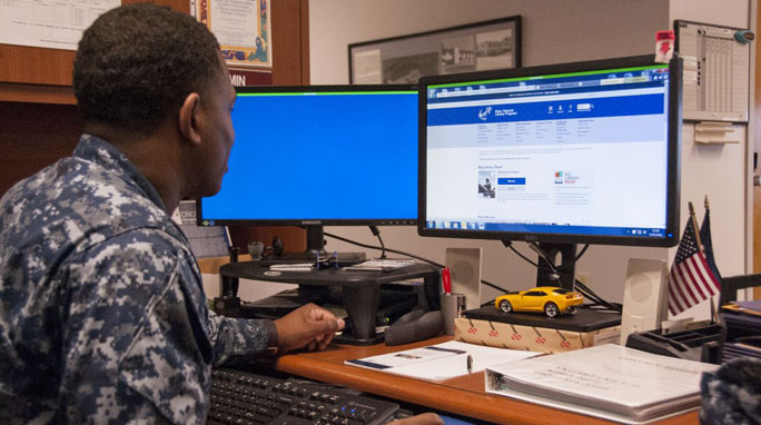 Aviation Structural Mechanic Airman looks through books on the Navy Morale, Welfare and Recreation (MWR) Digital Library website.