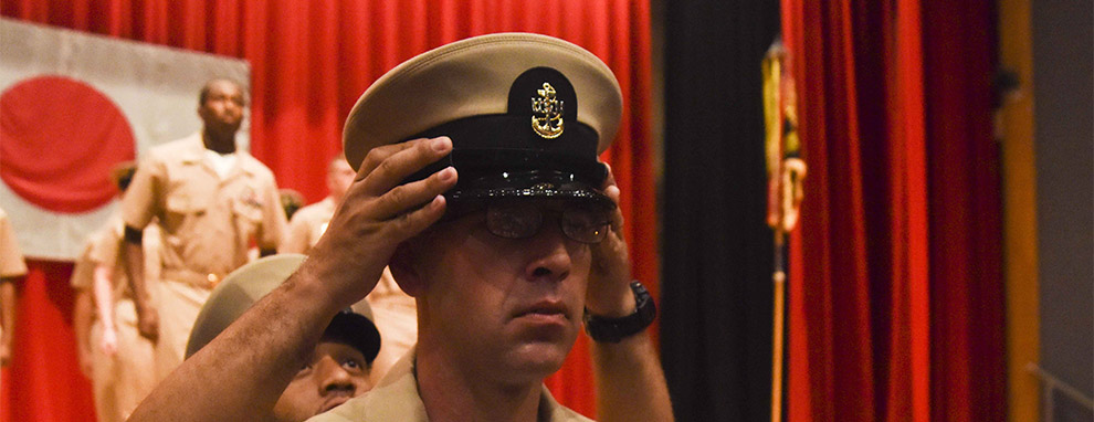 Chief Cryptological Technician (Collection) receives his chief petty officer cover during a chief petty officer pinning ceremony held at Commander Fleet Activities Yokosuka. (U.S. Navy Photo by Mass Communication Specialist 1st Class Brian G. Reynolds/Released)
