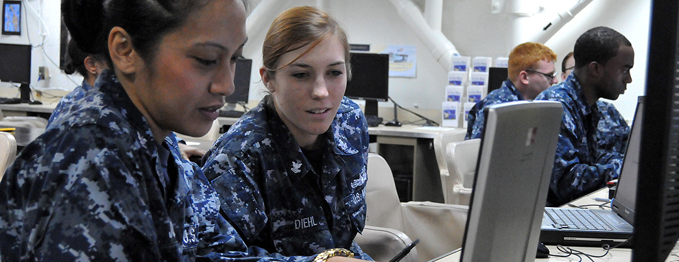 Sailors at a laptop computer